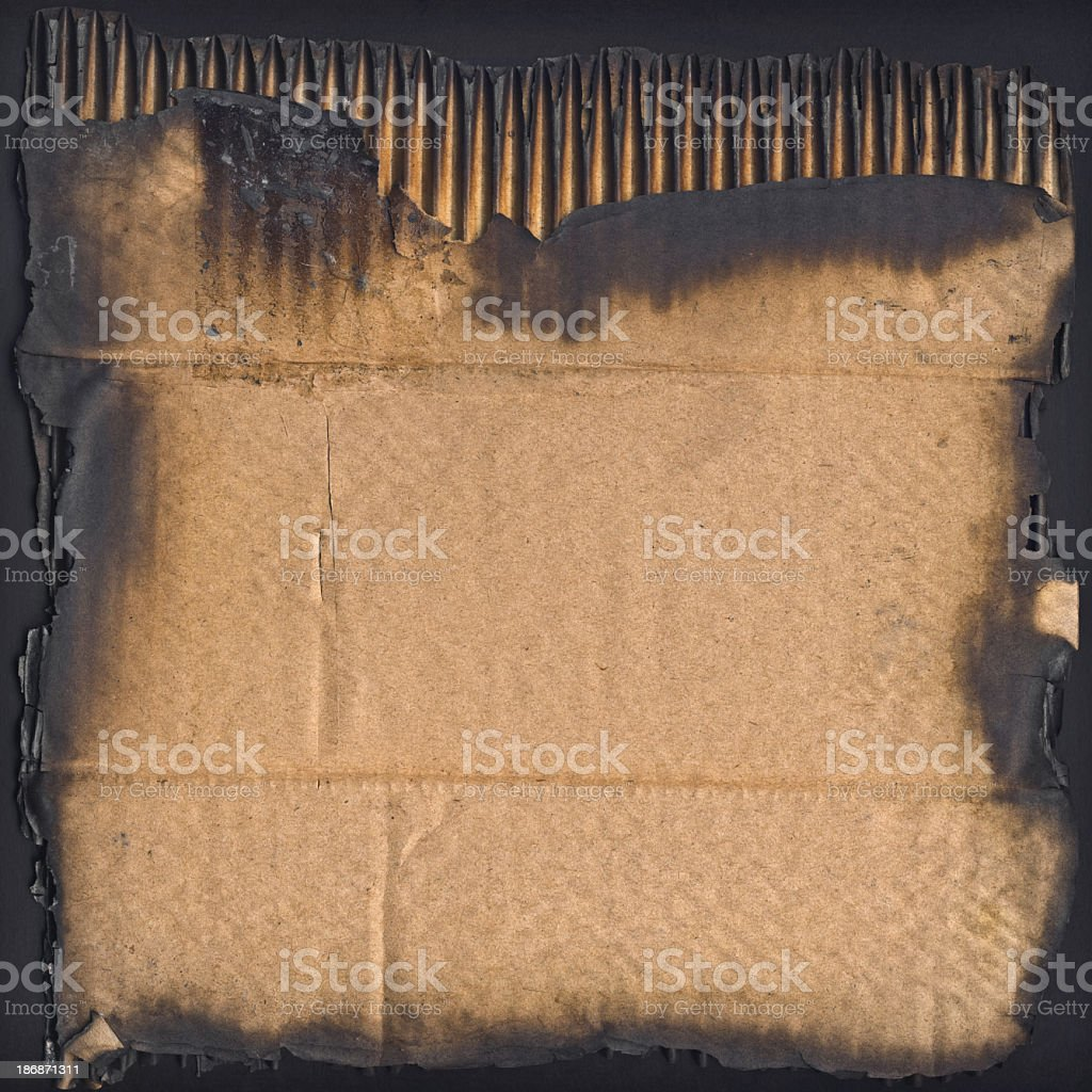 High Resolution Burnt Corrugated Cardboard Vignette Grunge Texture royalty-free stock photo