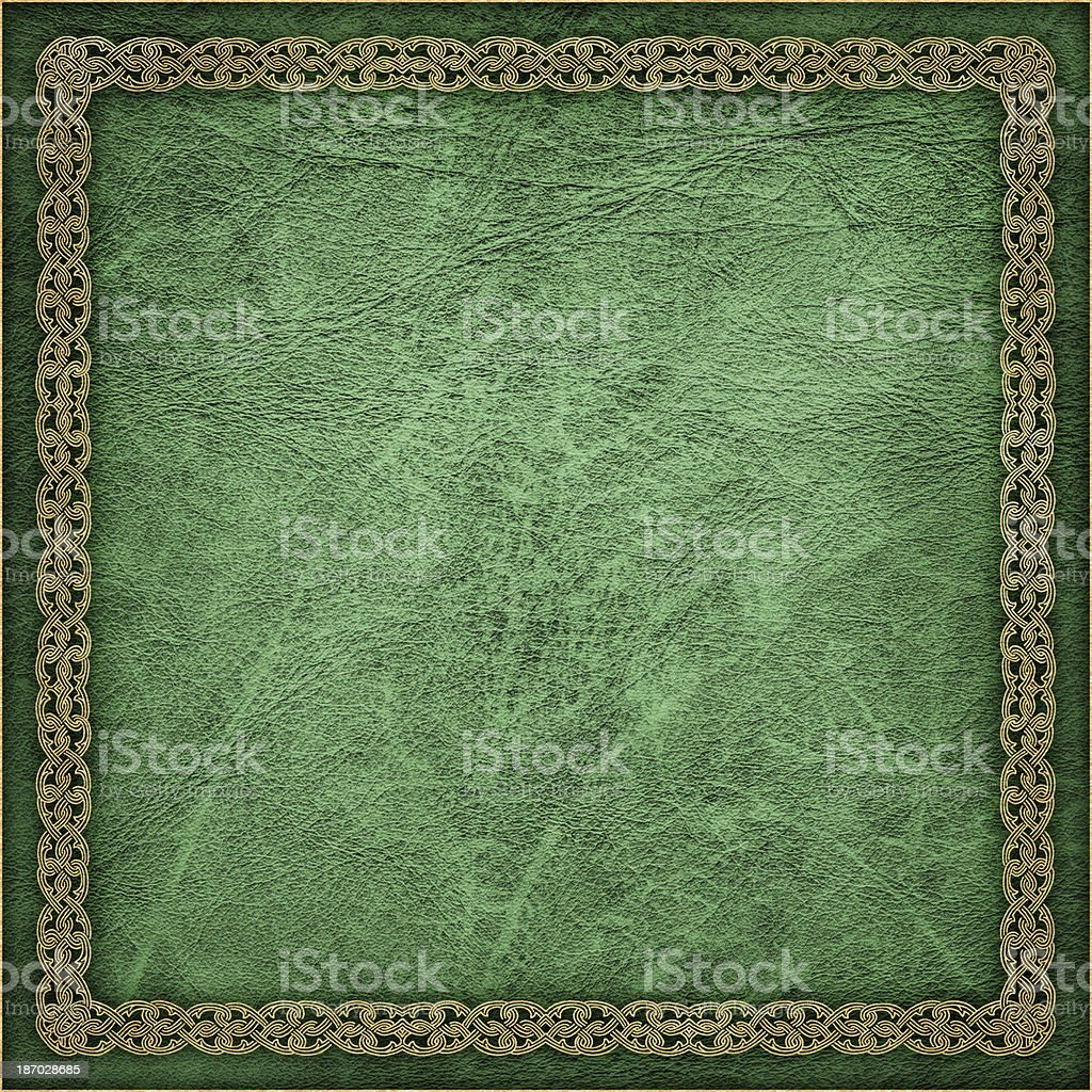 High Resolution Green Animal-skin Parchment with Decorative Arabesque Gilded Border stock photo