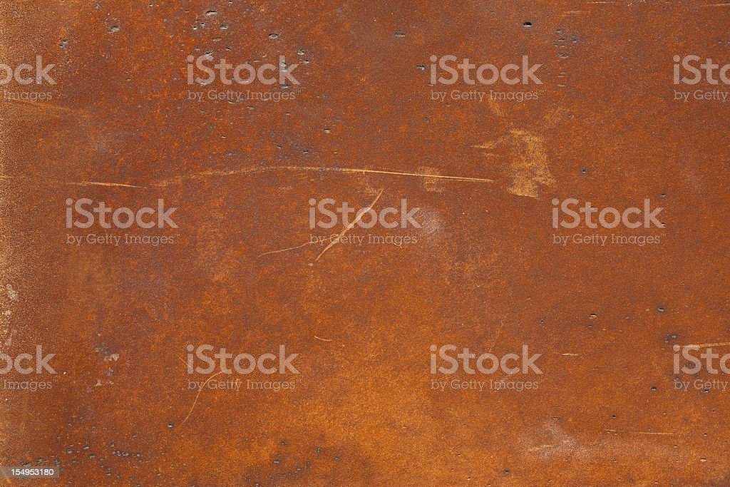A high resolution rusty metal surface with scratch marks stock photo