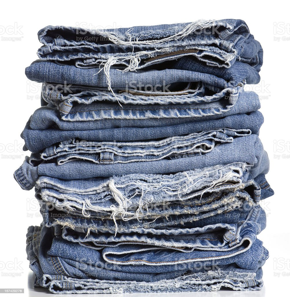 High Resolution Stack of Frayed Denim Jeans stock photo