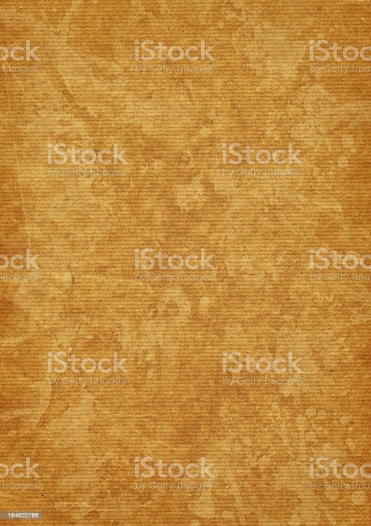 High Resolution Yellow Striped Kraft Paper Mottled Grunge Texture royalty-free stock photo