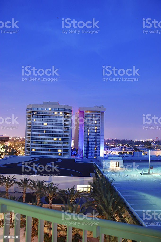 high rise at twilight stock photo
