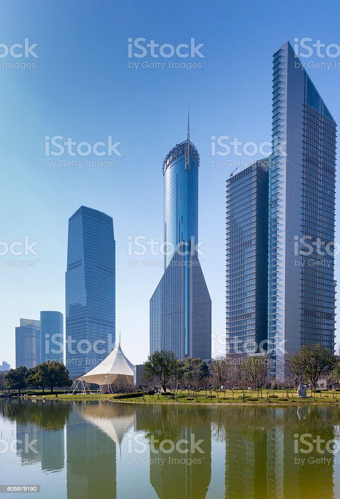 High rise building and small lake stock photo