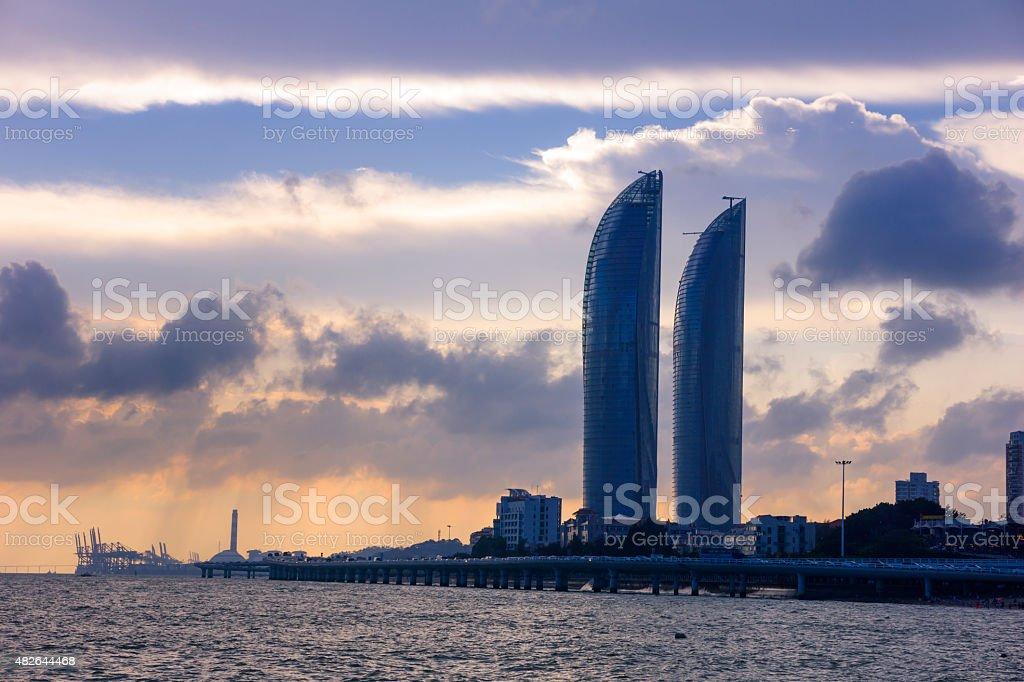 High rise building and xiamen yanwu bridge at dusk stock photo
