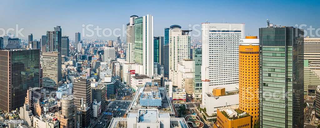 High rise cityscape crowded skyscrapers busy highways panorama Osaka Japan stock photo
