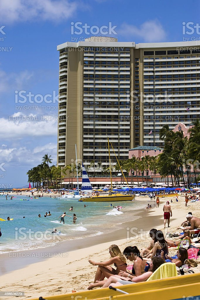 High rise Hotel and tourists on Waikiki Beach royalty-free stock photo