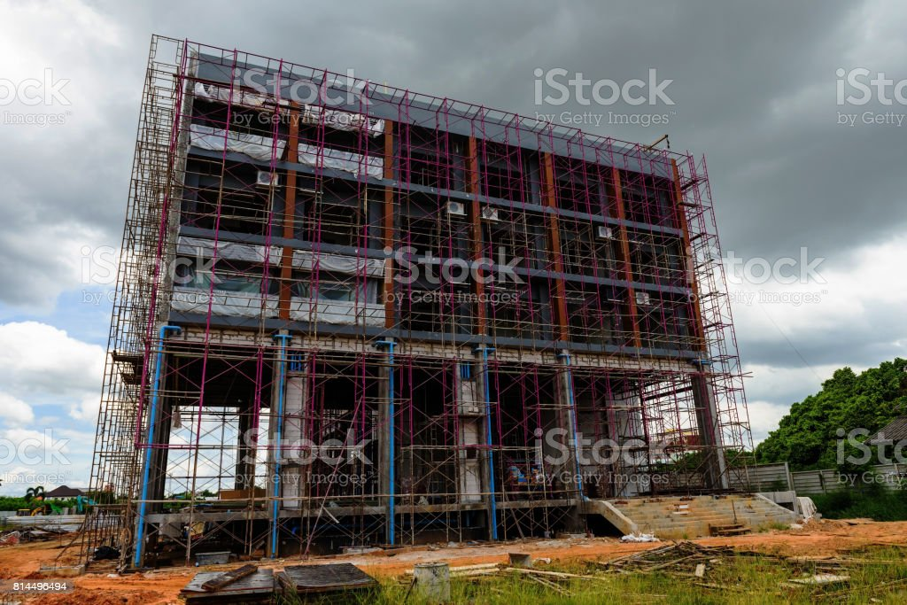 High rise luxury construction building with iron scaffold stock photo