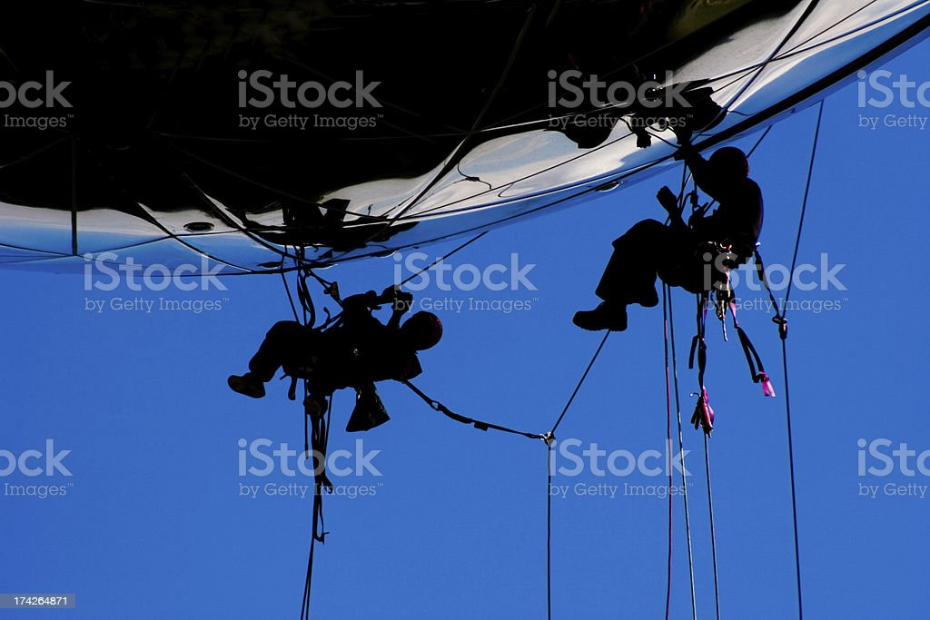 High risk teamwork for construction workers stock photo