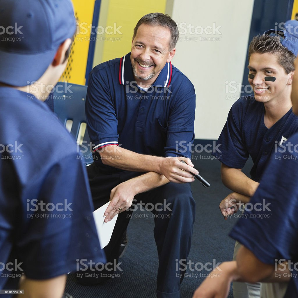 High school baseball ocach talking with players in locker room stock photo