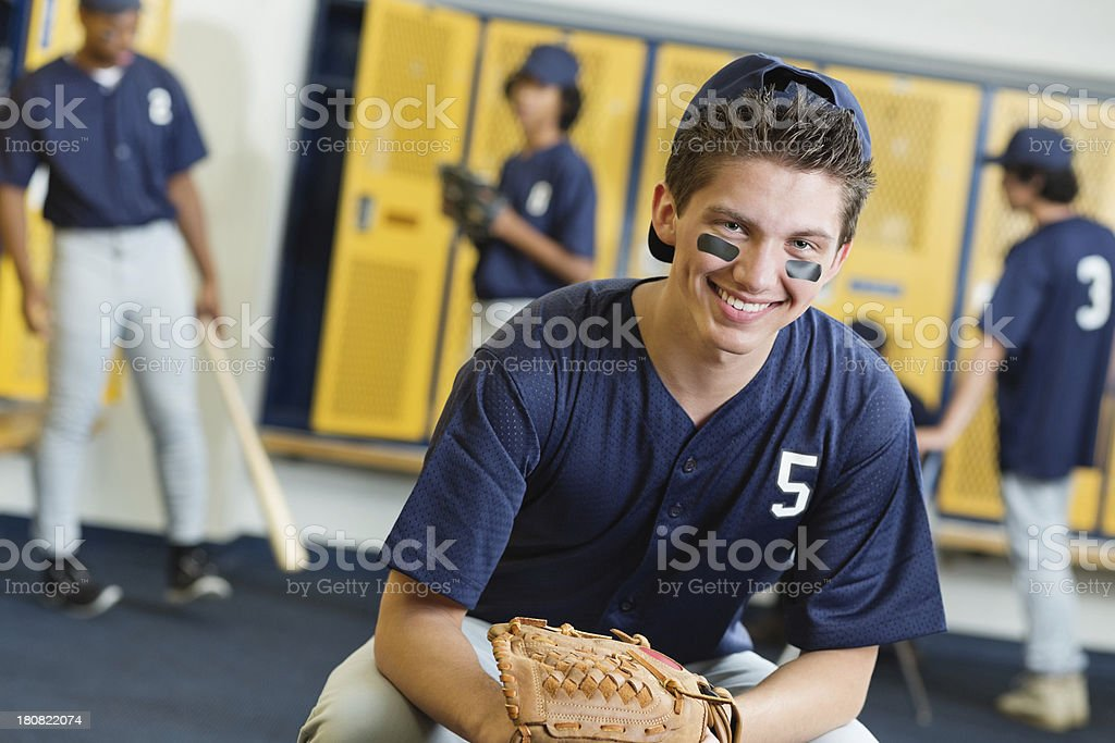 High School Baseball Player In Locker Room After Winning Game Royalty Free Stock Photo