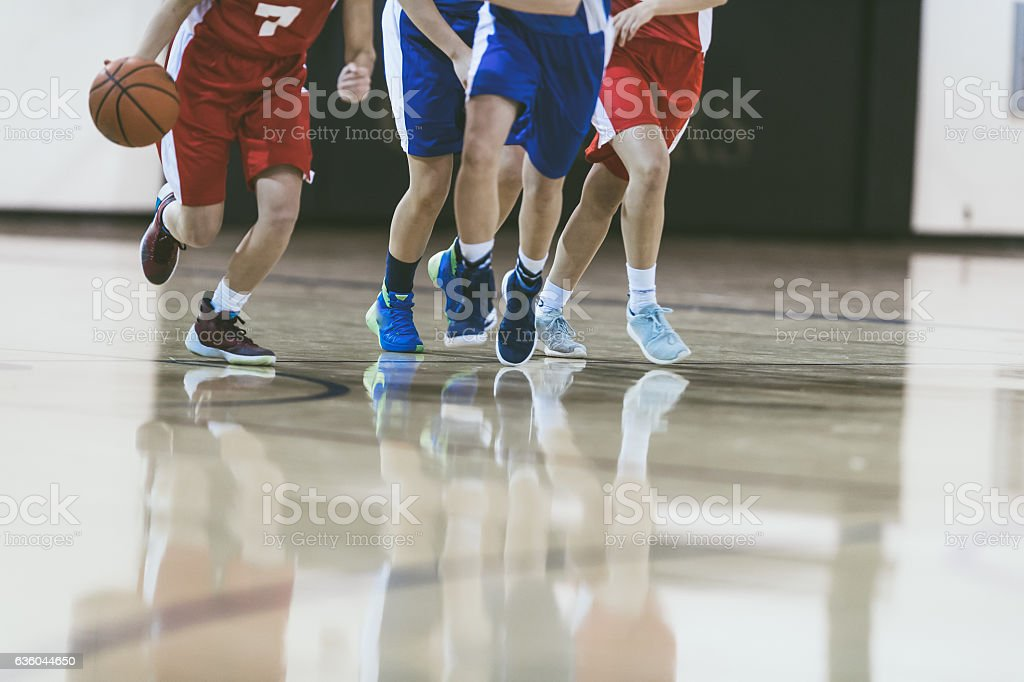 High school basketball player driving to the hoop stock photo