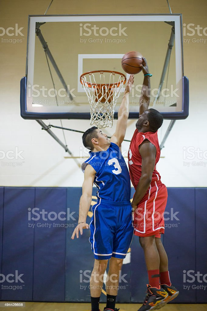 High school basketball player dunking stock photo
