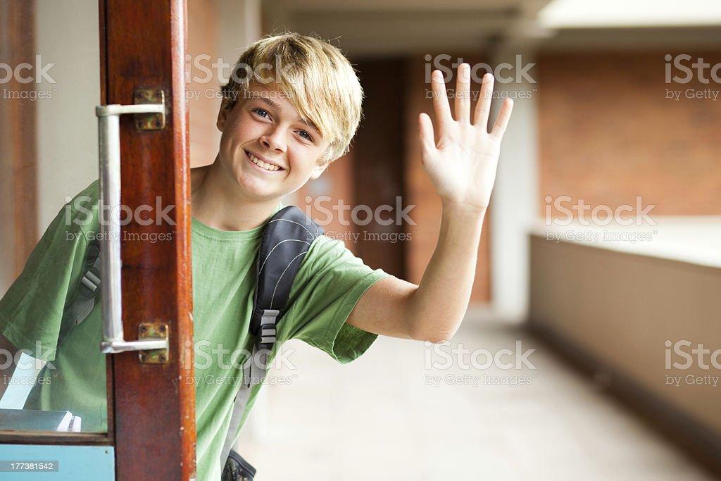 high school boy waving good bye stock photo