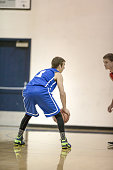 High school boys playing basketball