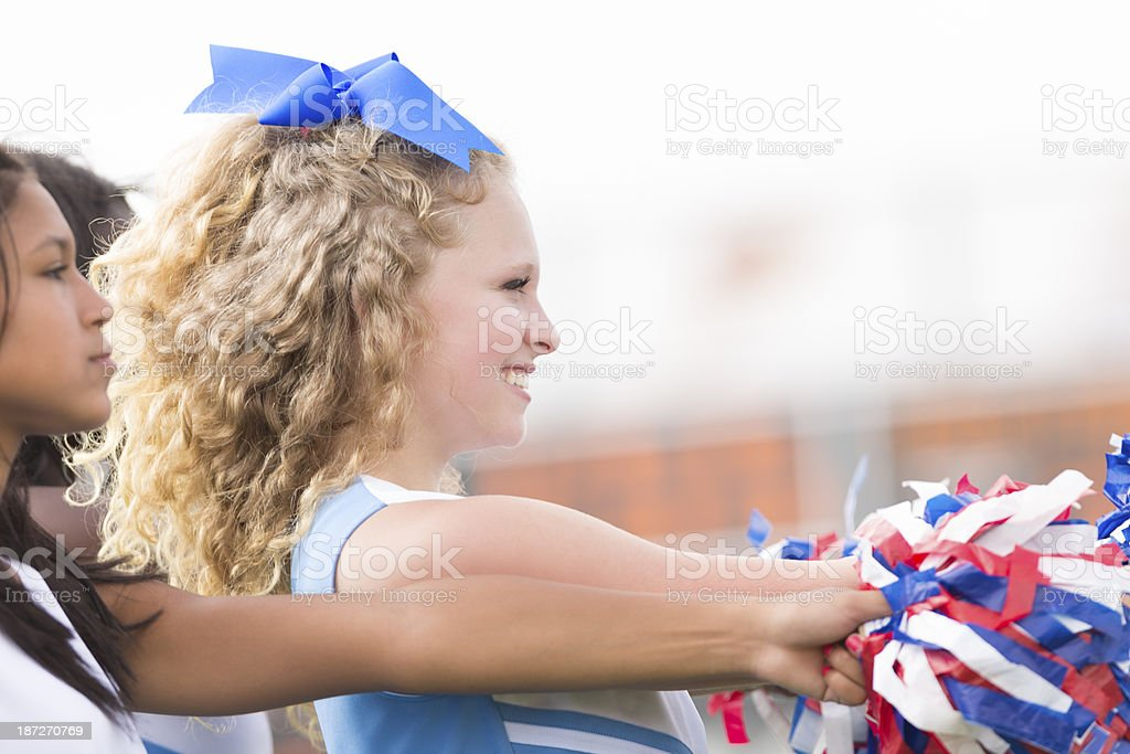High school cheerleaders cheering at football game royalty-free stock photo