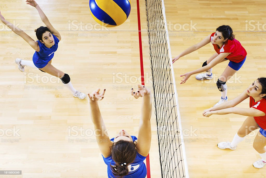 High school female volleyball team in action. stock photo