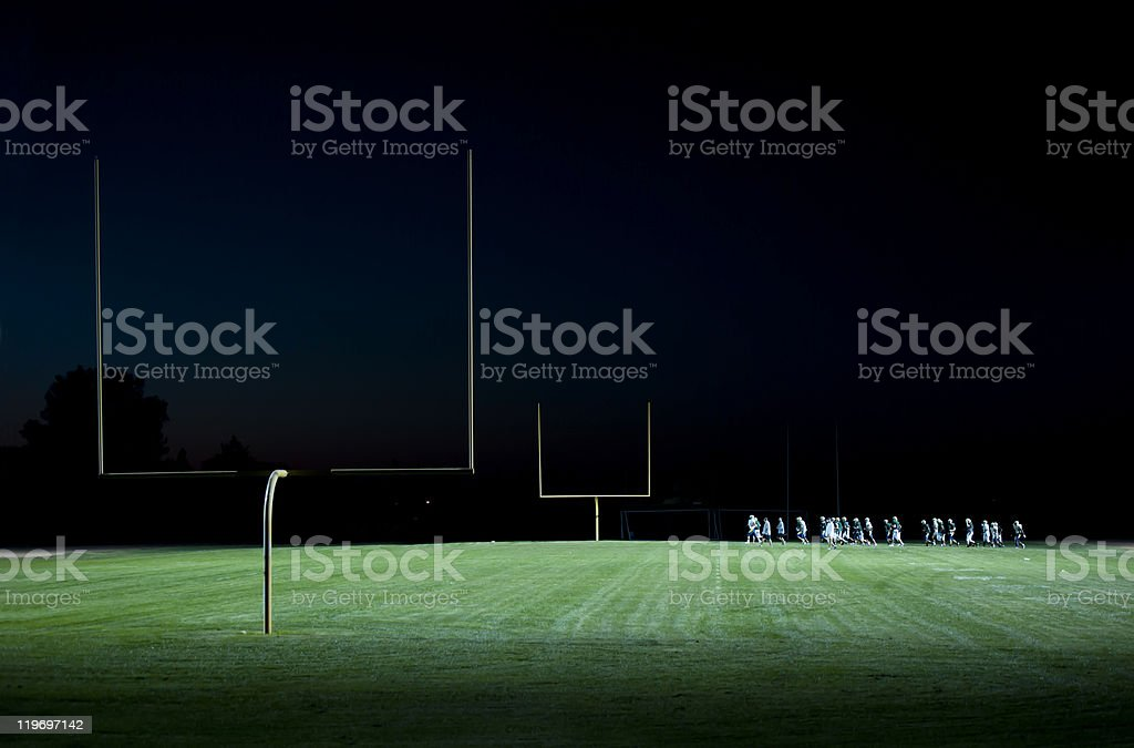 high school foot ball practice on the field stock photo