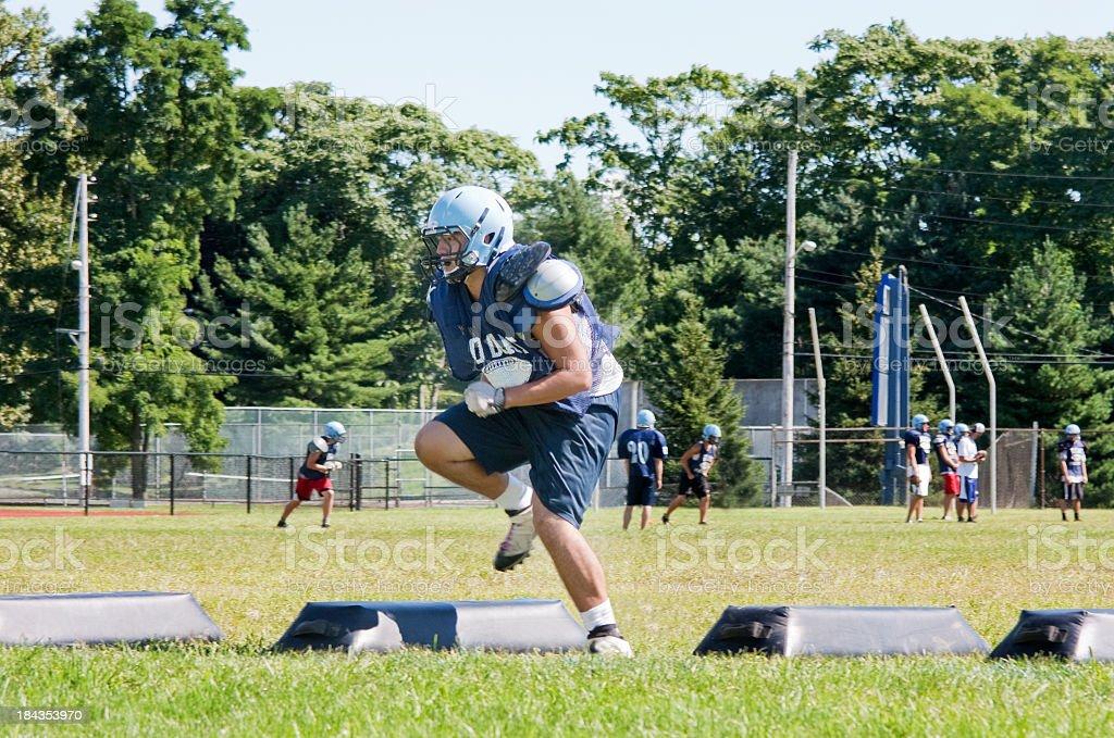 high school football player training stock photo