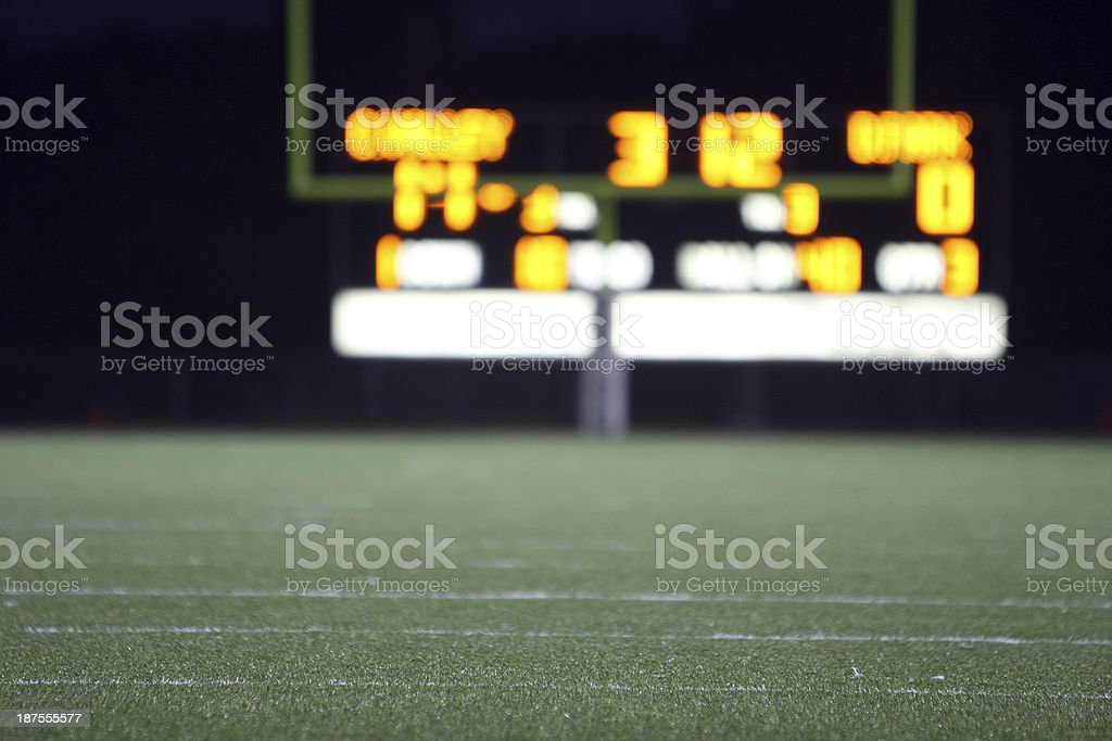 High school football score seen from distance stock photo