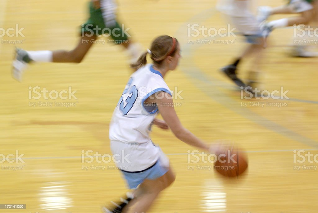 High school girls basketball action stock photo