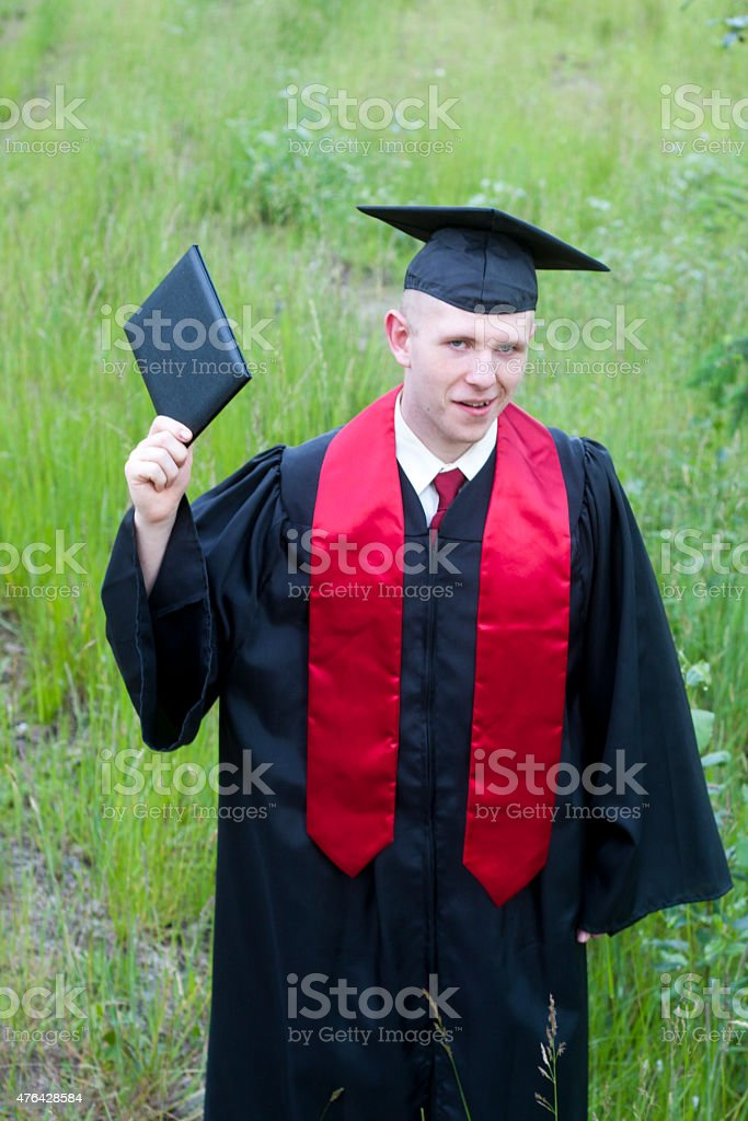 High School Graduate with Raised Diploma stock photo