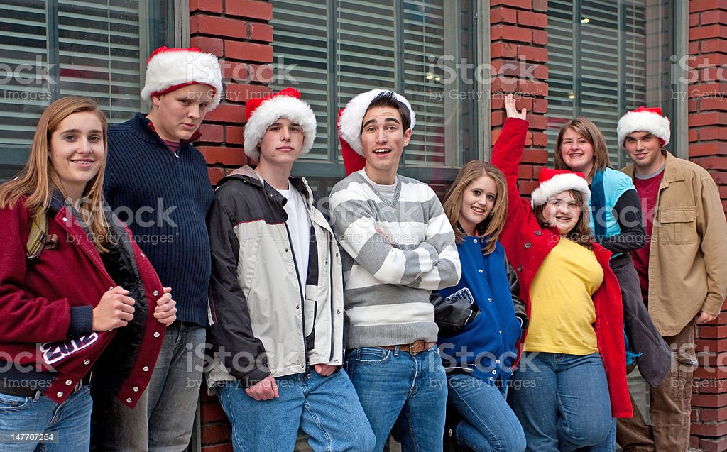 High School Kids against Brick Wall royalty-free stock photo
