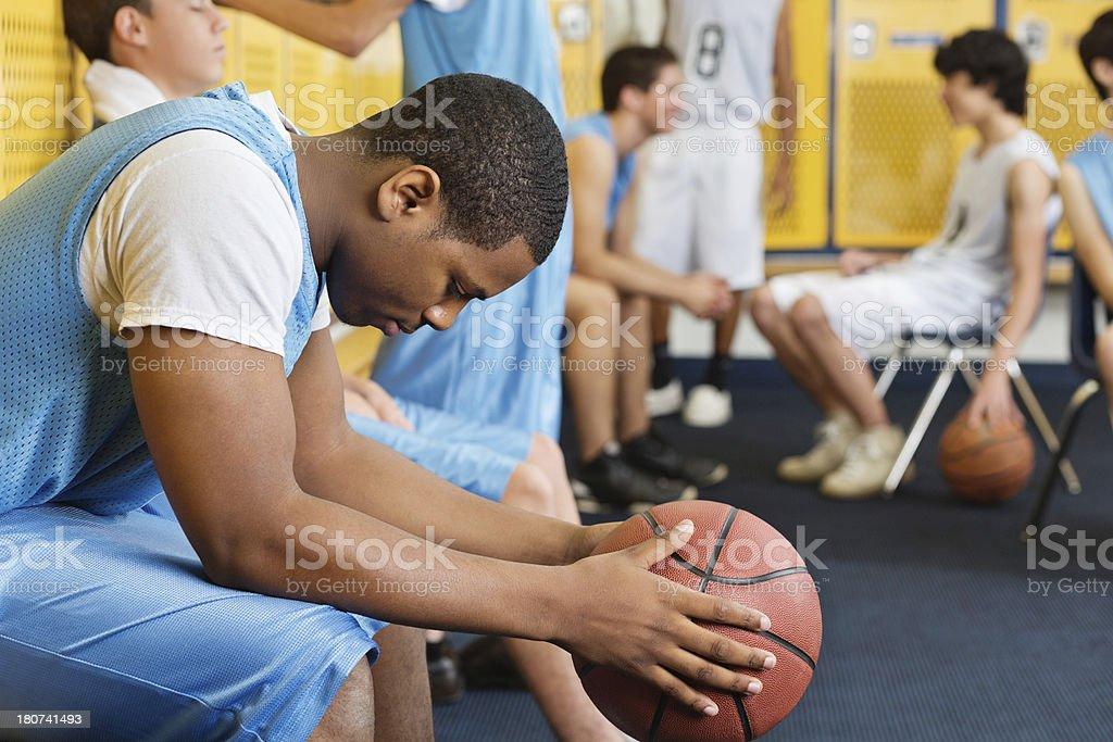 High school locker room with basketball team players royalty-free stock photo