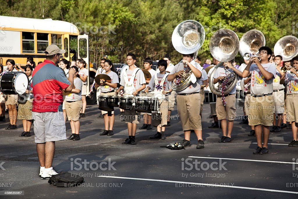 High School marching band warms up prior to parade stock photo