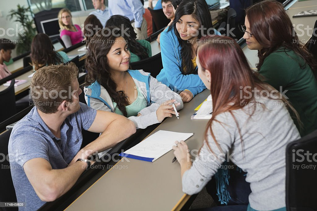 High school or college students working on class assignment together royalty-free stock photo