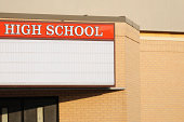 High school sign with marquee and copy space