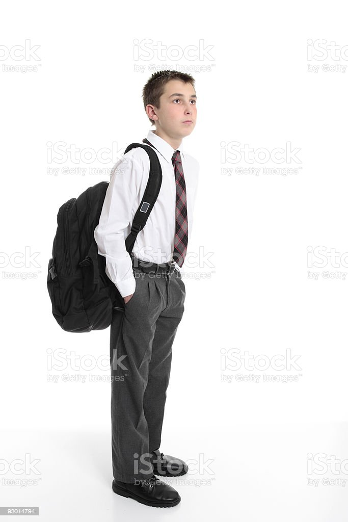 High school student carrying backpack bag stock photo
