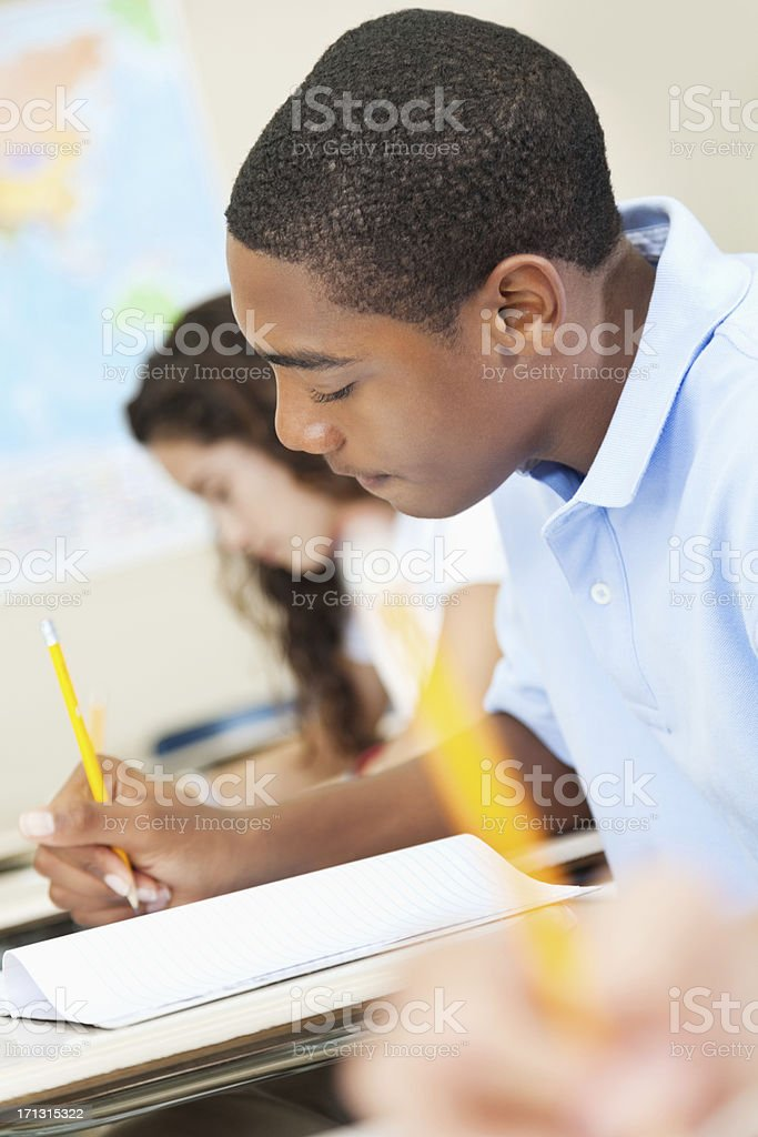 High school student concentrating on work during class stock photo