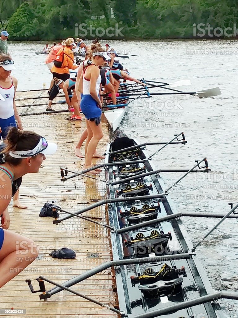 High School student rowing team getting ready for their daily practice stock photo