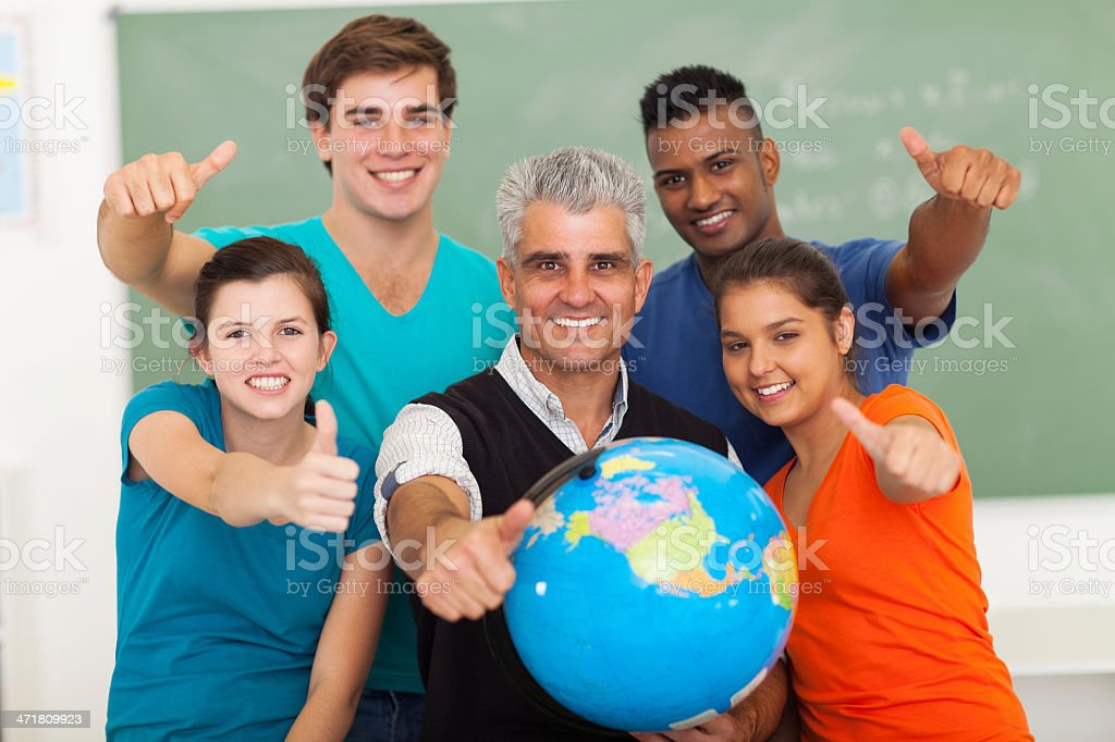 high school students and senior teacher giving thumbs up royalty-free stock photo