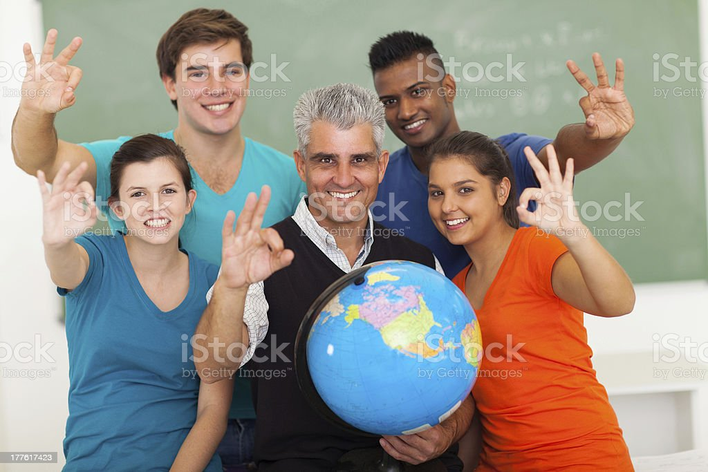 high school students and teacher giving okay sign royalty-free stock photo