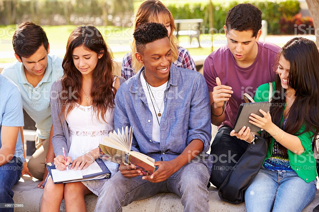 .High School Students Collaborating On Project On Campus stock photo