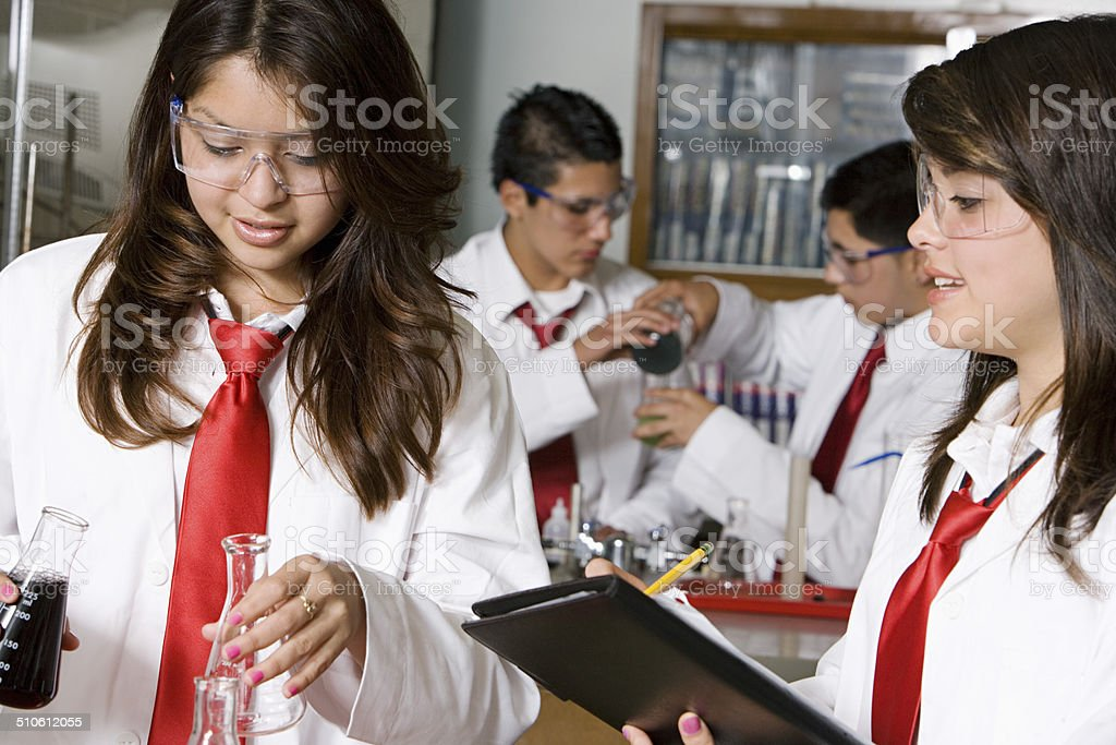 High School Students Conducting Experiment stock photo