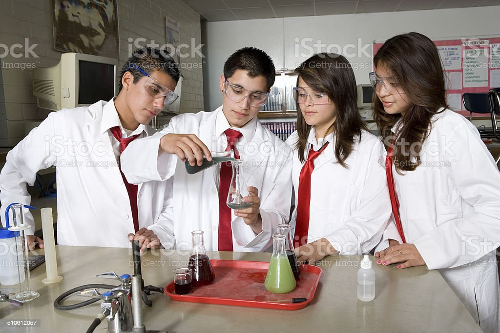 High School Students Conducting Science Experiment stock photo