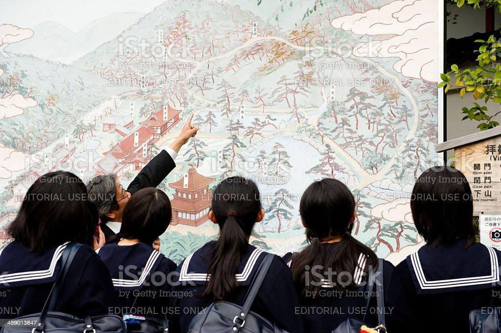 High school students looking at map ,Ginkakuji Temple , Kyoto,Japan royalty-free stock photo