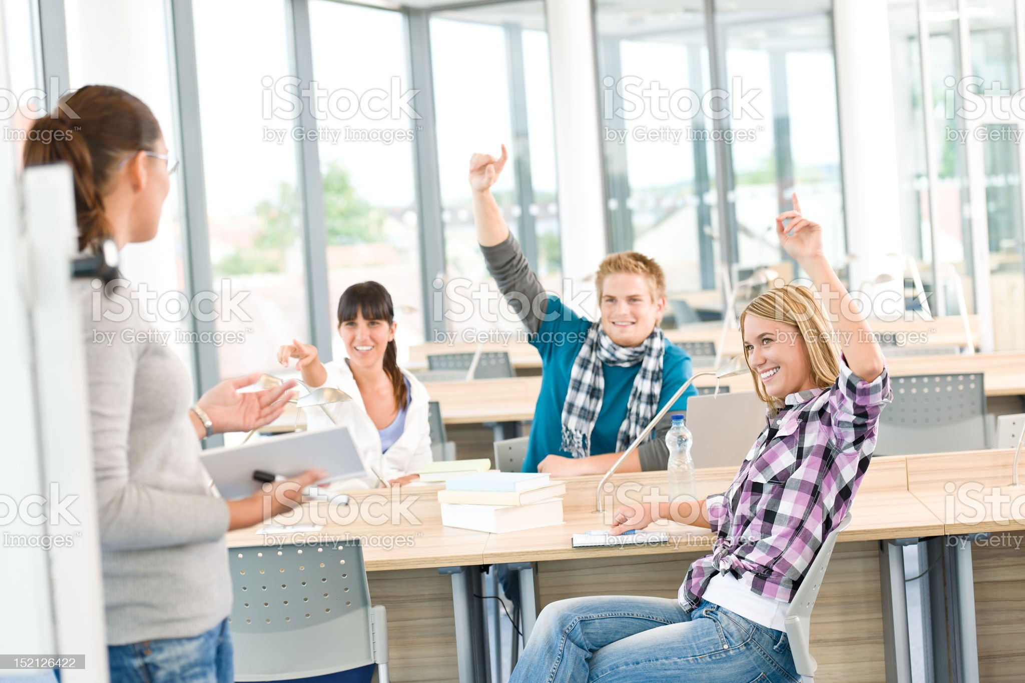 High school students raising hands royalty-free stock photo