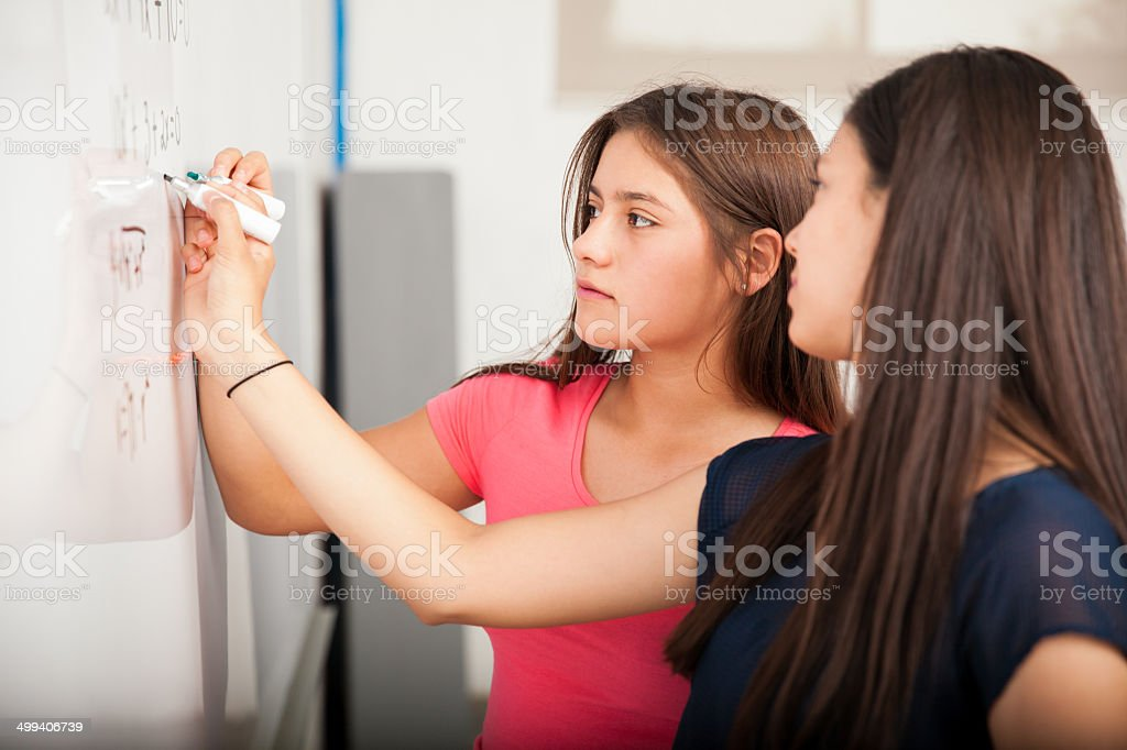 High school students solving problem stock photo