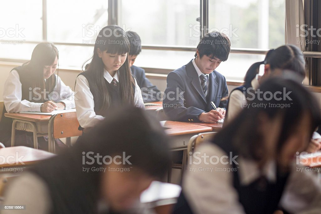 High school students studying in classroom stock photo