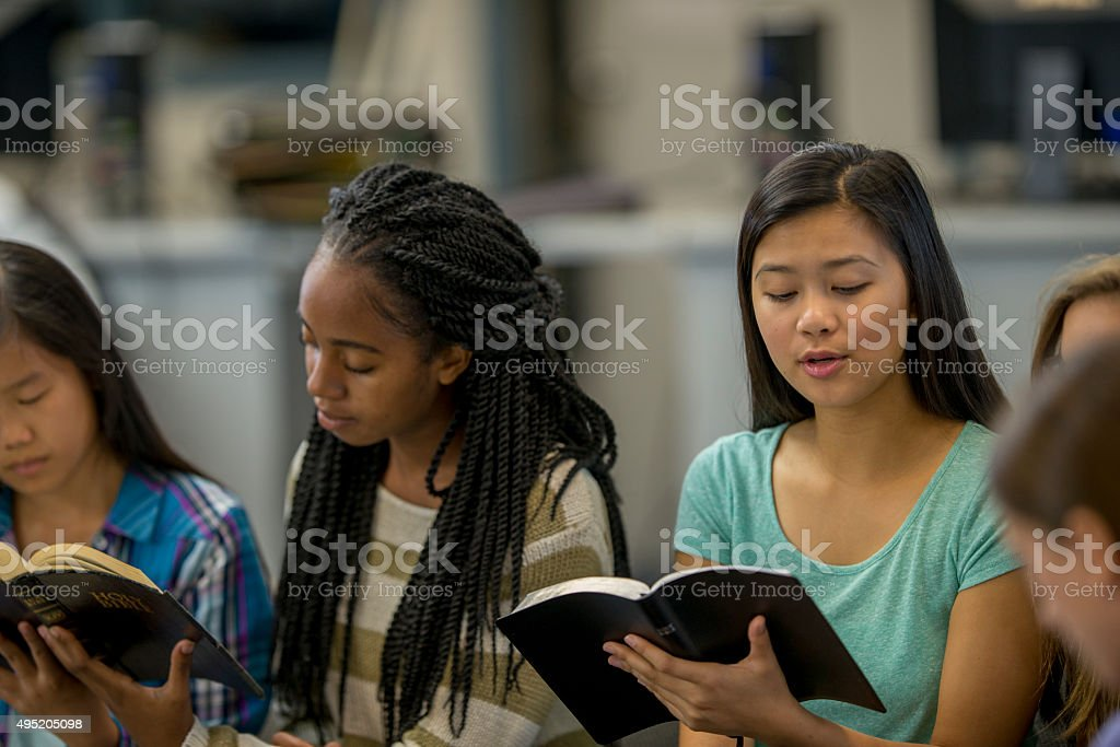 High School Students Studying Scripture Together stock photo