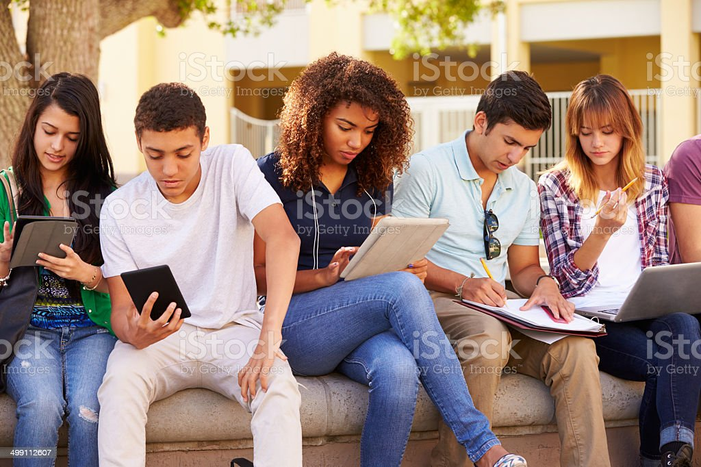 High school students working together on project stock photo