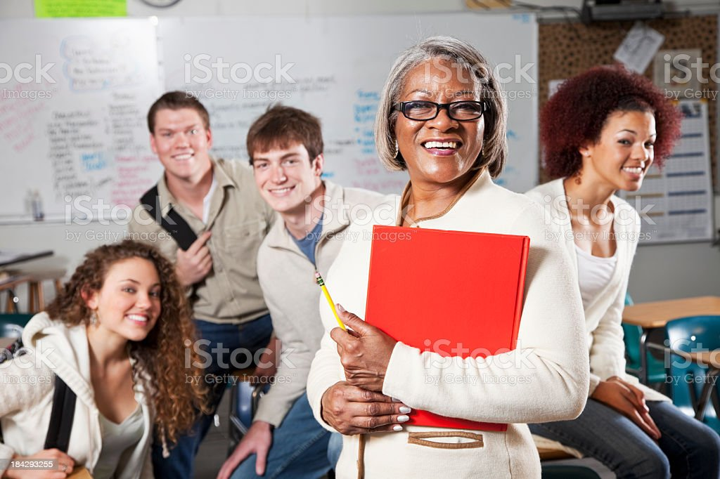 High school teacher with students in class stock photo