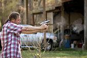 High speed image of a man firing a hand gun