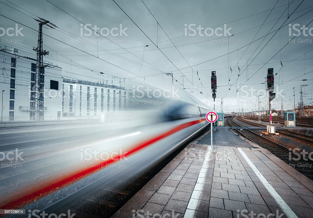High speed passenger train on tracks in motion stock photo
