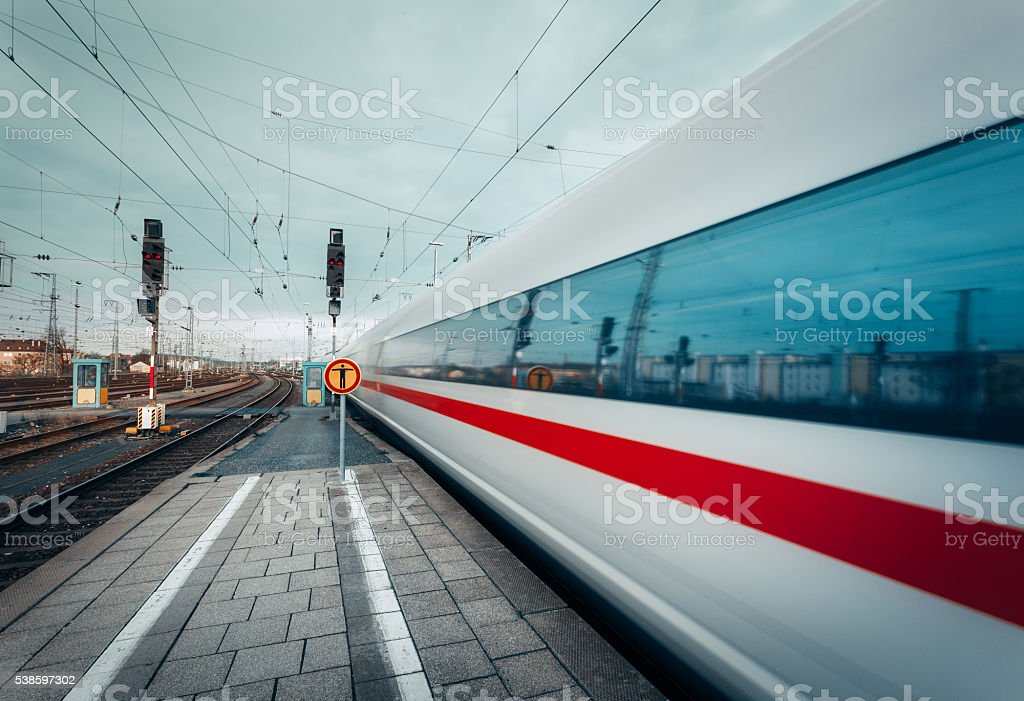 High speed passenger train on tracks in motion stock photo