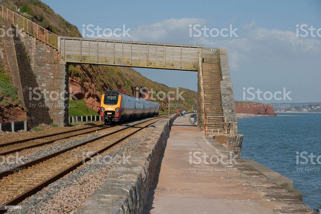 High speed train by the sea wall at Dawlish, Devon stock photo