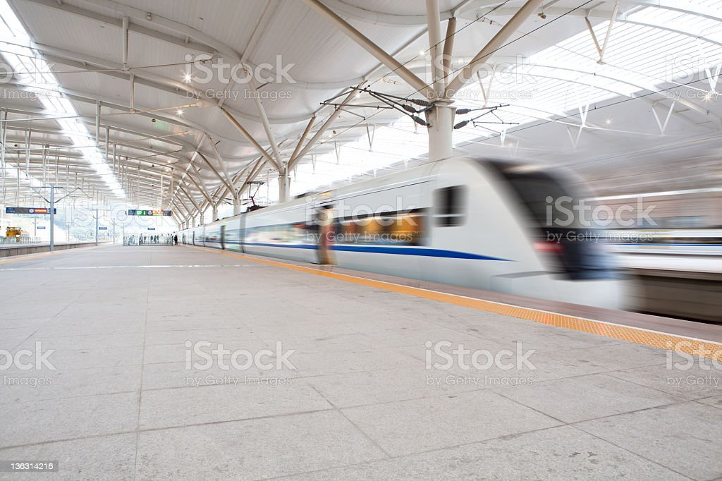 High speed train fast passing station with motion blur. royalty-free stock photo